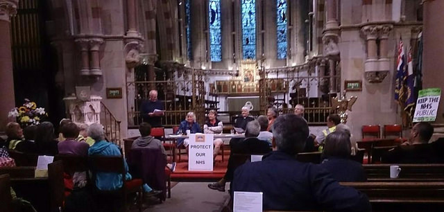 end of Ripon to Harrogate People's March for NHS leg - sitting in a church eating supper and listening to speakers